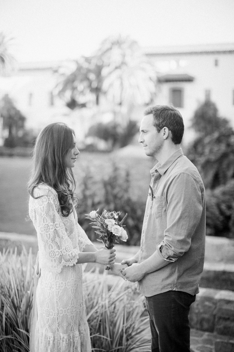 Candid black and white photo of couple elopement at the Santa Barbara courthouse.