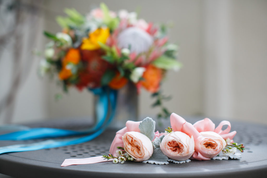 Beautiful boutonnieres and bridal bouquet by Coco Rose Design